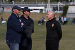 CARY, NC - APRIL 08: Courage head coach Paul Riley (ENG) (right) talks with UNC assistant coaches Bill Palladino (left) and Damon Nahas (center). The NWSL's North Carolina Courage played a preseason game against the University of North Carolina Tar Heels on April 8, 2017, at WakeMed Soccer Park Field 3 in Cary, NC. The Courage won the match 1-0.