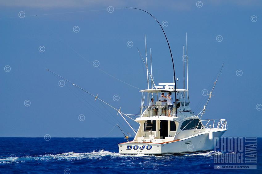 Sport fishing boat with Hawaiian Green Stick tuna rig, Kona Coast, Big Island