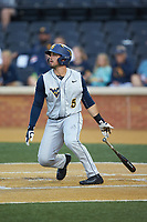 Kyle Davis (5) of the West Virginia Mountaineers follows through on his swing against the Wake Forest Demon Deacons in Game Six of the Winston-Salem Regional in the 2017 College World Series at David F. Couch Ballpark on June 4, 2017 in Winston-Salem, North Carolina. The Demon Deacons defeated the Mountaineers 12-8. (Brian Westerholt/Four Seam Images)