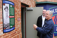 New Boston Red Sox manager Bobby Valentine takes a photo with his cell phone of the Tommy Lasorda plaque on January 23, 2012, at Fluor Field at the West End in Greenville, South Carolina. Behind Valentine is Greenville Drive General Manager Mike deMaine. Valentine was in town to speak at the annual Greenville Drive Hot Stove Event. (Tom Priddy/Four Seam Images)