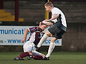 Stenny's Ross McMillan blocks Stranraer's Craig Malcolm shot late on in the game.