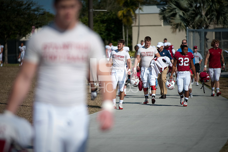 MIAMI, FL--The Stanford Cardinal makes their way to the field during practice at Barry University in Miami, Florida.