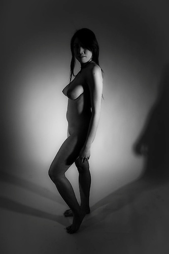 Naked female shot in studio with sigened model release.