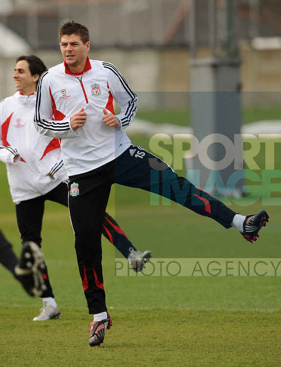 Steven Gerrard of Liverpool takes part in training before Tuesday nights Champions League tie against Arsenal