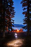 USA, Oregon, Paulina Lake, Brown Cannon, a group of campers sitting around the campfire at Paulina Lake