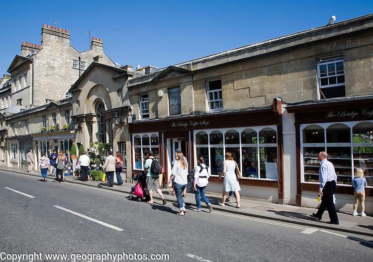 People shopping at shops on Pulteney Bridge, Bath, Somerset, England