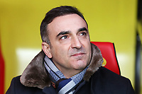 Swansea manager Carlos Carvalhal sits in the dugout during the Premier League match between Watford and Swansea City at the Vicarage Road, Watford, England, UK. Saturday 30 December 2017