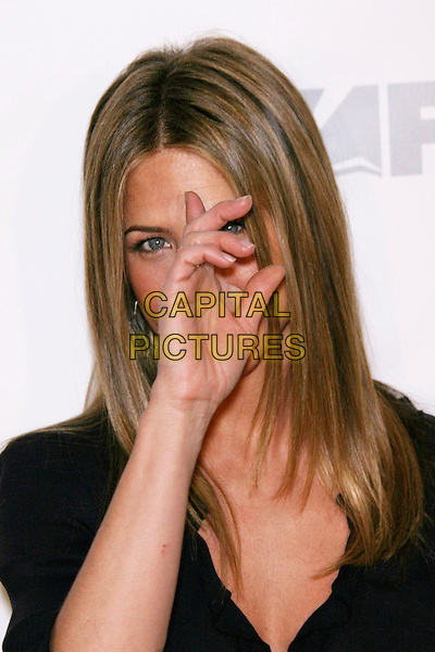 "JENNIFER ANISTON.FX Hosts the premiere screening of ""Dirt"" - Arrivals .held at Paramount Theatre, Los Angeles, California, .USA, 9 December 2006..portrait headshot black dress hand finger touching face hiding itching scratching.CAP/ADM/ZL.©Zach Lipp/AdMedia/Capital Pictures"