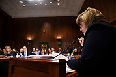 Christine Blasey Ford (L), the woman accusing Supreme Court nominee Brett Kavanaugh of sexually assaulting her at a party 36 years ago, answers questions by Rachel Mitchell (R), a prosecutor from Arizona, as she testifies before the US Senate Judiciary Committee on Capitol Hill in Washington, DC, September 27, 2018.  / POOL / SAUL LOEB