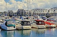 Pleasure Boats sit along the docks in the Sturgeon Bay Harbor with the Michigan Avenue Bridge in the distance, Sturgeon Bay, Door County, Wisconsin