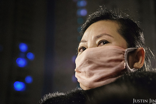 A landless farmer protects herself from dust that emit from construction sites erected over her former farmland. <br /> <br /> China is pushing ahead with a dramatic, history-making plan to move 100 million rural residents into towns and cities over six years &mdash; but without a clear idea of how to pay for the gargantuan undertaking or whether the farmers involved want to move.<br /> <br /> Moving farmers to urban areas is touted as a way of changing China&rsquo;s economic structure, with growth based on domestic demand for products instead of exporting them. In theory, new urbanites mean vast new opportunities for construction firms, public transportation, utilities and appliance makers, and a break from the cycle of farmers consuming only what they produce.<br /> <br /> Urbanization has already proven to be one of the most wrenching changes in China&rsquo;s 35 years of economic reforms. Land disputes rising from urbanization account for tens of thousands of protests each year.