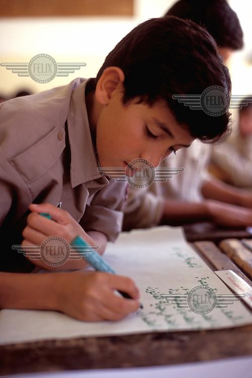 © Giacomo Pirozzi / Panos Pictures..JORDAN..Boy in primary school.