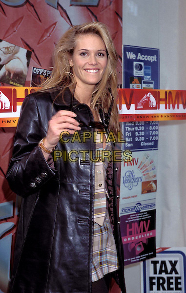 "ELLE MACPHERSON.HMV Promotion.Ref: 911.australian supermodel, ""the body"", sunglasses, shades, leather jacket, smiling, , half length, half-length.www.capitalpictures.com.sales@capitalpictures.com.© Capital Pictures"