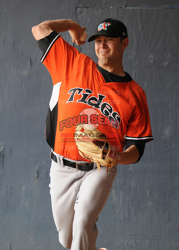 Pitcher Chris Tillman (22) of the Norfolk Tides, International League affiliate of the Baltimore Orioles, prior to a game against the Scranton/Wilkes-Barre Yankees on June 20, 2011, at PNC Park in Moosic, Pennsylvania. (Tom Priddy/Four Seam Images).