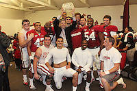 STANFORD, CA - NOVEMBER 28:  James McGillicuddy, Josh Catron, Chris Marinelli, Allen Smith, Jim Dray, Tavita Pritchard, Bob Bowlsby, Erik Lorig, Kris Evans, Bo McNally, Tom McAndrew, Will Powers, Ekom Udofia and Andrew Fowler of the Stanford Cardinal after Stanford's 45-38 win over the Notre Dame Fighting Irish on November 28, 2009 at Stanford Stadium in Stanford, California.