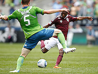 Colorado Rapids forward Sanna Nyassi takes a shot on goal against Seattle Sounders FC defender Tyson Wahl at CenturyLink Field in Seattle Saturday July 17, 2011. The Sounders won the game 4-3.