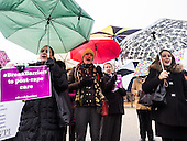 Participants calling on president Obama to ensure the United States is a leader in providing comprehensive, post-rape care, including safe abortion services, to survivors of sexual violence listen to speakers in front of the White House in Washington, DC.<br /> <br /> PHOTOS/John Nelson
