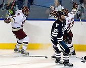 Brian Gibbons (BC - 17) and Cam Atkinson (BC - 13) celebrate Gibbons' goal which opened scoring in the game. - The Boston College Eagles defeated the Yale University Bulldogs 9-7 in the Northeast Regional final on Sunday, March 28, 2010, at the DCU Center in Worcester, Massachusetts.