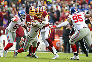 Landover, MD - December 9, 2018: Washington Redskins Josh Johnson (8) gets tackled during the  game between New York Giants and Washington Redskins at FedEx Field in Landover, MD.   (Photo by Elliott Brown/Media Images International)