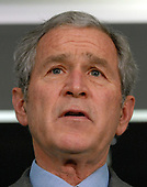 United States President George W. Bush speaks to the media after visiting the Office of the Director of National Intelligence and the National Counterterrorism Center in McLean, Virginia, on December 8, 2008.  <br /> Credit: Roger L. Wollenberg / Pool via CNP