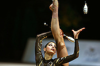 Stela Sultanova of Bulgaria re-catches clubs during All-Around competition at 2006 Thiais Grand Prix in Paris, France on March 25, 2006.  (Photo by Tom Theobald)
