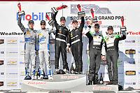 #33 Riley Motorsports Mercedes AMG GT3, GTD: Jeroen Bleekemolen, Ben Keating celebrates the win in Victory Lane on the podium with #14 3GT Racing Lexus RCF GT3, GTD: Dominik Baumann, Kyle Marcelli, #44 Magnus Racing Audi R8 LMS GT3, GTD: John Potter, Andy Lally