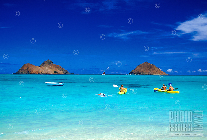 EDITORIAL ONLY. Kayaking to the Mokulua Islands, windward side, Oahu