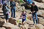 August 15, 2015 - Manitou Springs, Colorado, U.S. - Boulder, Colorado runner, Andy Wacker, carefully negotiates the final rocky steps to finish second in the Pikes Peak Ascent during the 60th running of the Pikes Peak Ascent and Marathon.  During the Ascent, runners cover 13.3 miles and gain more than 7815 feet (2382m) by the time they reach the 14,115ft (4302m) summit.  On the second day of race weekend, 800 marathoners will make the round trip and cover 26.6 miles of high altitude and very difficult terrain in Pike National Forest, Manitou Springs, CO.