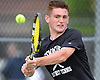 Keegan Morris of Sewanhaka District (Carey High School) returns a volley from Plainview JFK's Yuval Solomon during the Nassau County varsity boys' tennis singles championship match at Oceanside High School on Satuday, May 16, 2015.<br /> <br /> James Escher