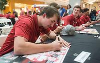 NWA Democrat-Gazette/BEN GOFF @NWABENGOFF<br /> Connor Noland, Arkansas right-hand pitcher, signs autographs Saturday, Feb. 9, 2019, during Arkansas baseball's annual Meet the Razorbacks Day at Northwest Arkansas Mall in Fayetteville.