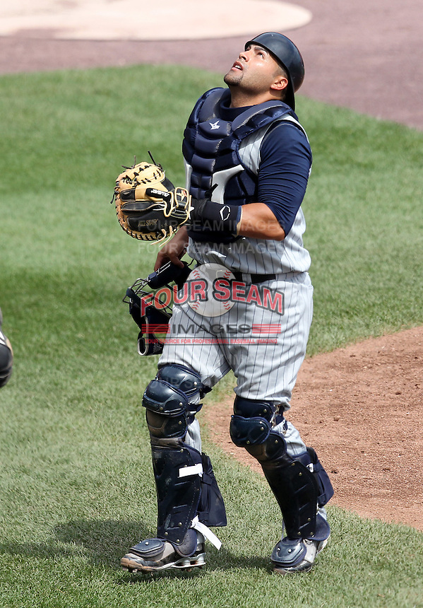 Toledo Mudhens catcher Omir Santos #24 during a game against the Buffalo Bisons at Coca-Cola Field on August 17, 2011 in Buffalo, New York.  Buffalo defeated Toledo 4-2.  (Mike Janes/Four Seam Images)