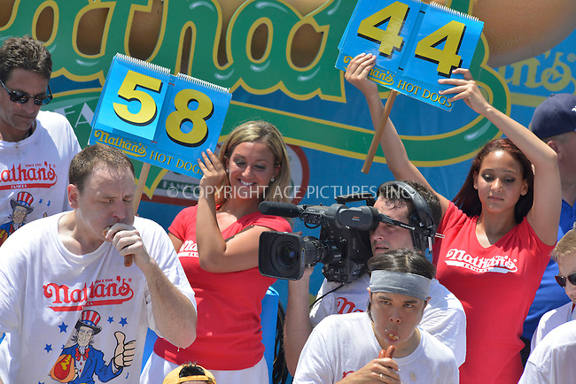 WWW.ACEPIXS.COM . . . . . <br /> July 4, 2013...New York City....Joey&quot;Jaws&quot; Chestnut  at Nathan's Hotdog Eating Contest in Coney Island on  July 4, 2013 in New York City. ....Please byline: CURTIS MEANS - WWW.ACEPIXS.COM.. . . . . . ..Ace Pictures, Inc: ..tel: (212) 243 8787 or (646) 769 0430..e-mail: info@acepixs.com..web: http://www.acepixs.com