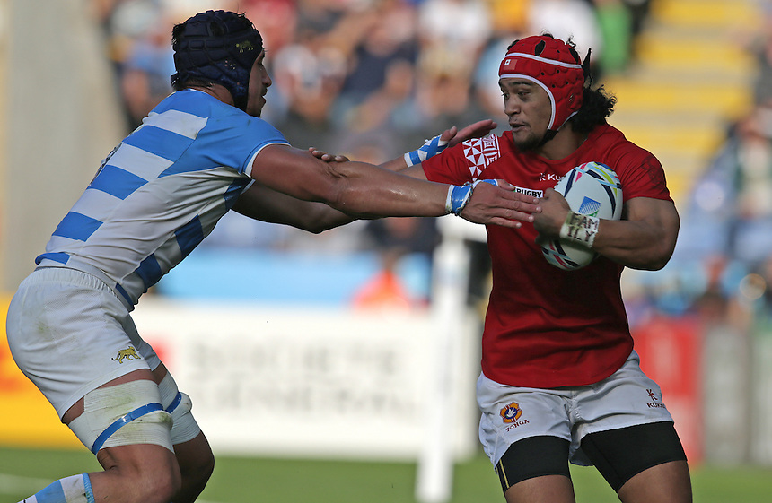 Tonga's Latiume Fosita is tackled by Argentina's Tomas Lavanini<br /> <br /> Photographer Stephen White/CameraSport<br /> <br /> Rugby Union - 2015 Rugby World Cup Pool C - Argentina v Tonga - Sunday 4th October 2015 - King Power Stadium - Leicester <br /> <br /> &copy; CameraSport - 43 Linden Ave. Countesthorpe. Leicester. England. LE8 5PG - Tel: +44 (0) 116 277 4147 - admin@camerasport.com - www.camerasport.com