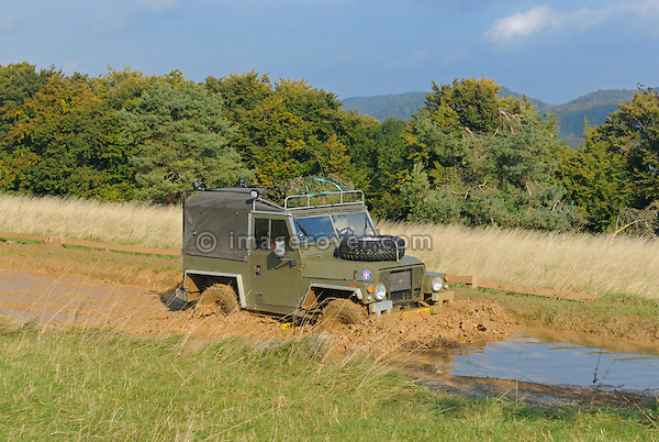 Ex-military Land Rover Lightweight crossing a flooded forest track. Seen at an off-road event of the German Land Rover Club held at the Freizeitpark Mammut in Stadtoldendorf, Germany, October 3.-5. 2008. --- No releases available. Automotive trademarks are the property of the trademark holder, authorization may be needed for some uses.