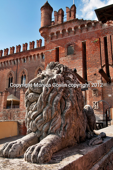 A stone lion guards the drawbridge to the Hotel and Spa Castello di Carimate, a castle near Como, Italy that dates back to the mid 1300's