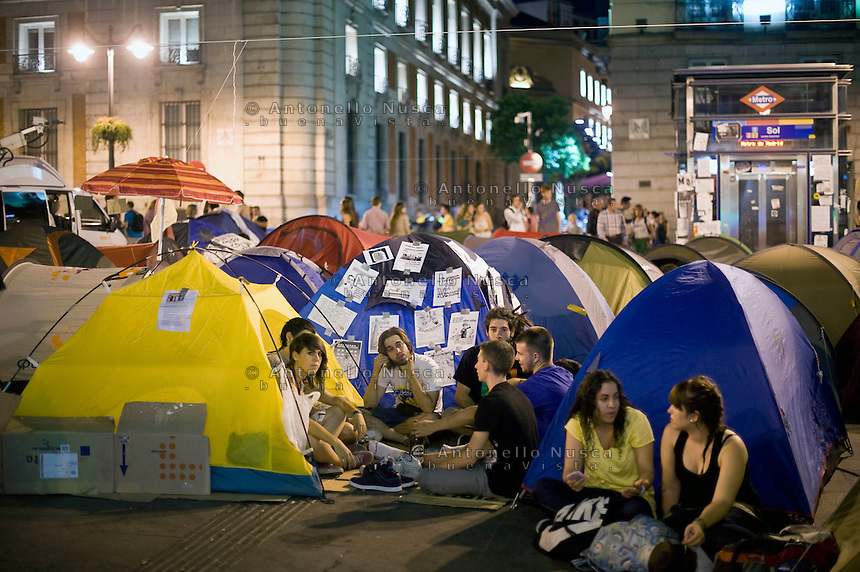 Los Indignados, the Spanish youth movement, continue demonstrating against unemployment and mainstream politics. The tent camp in Plaza del Sol..Los Indignados continuano la loro protesta in Plaza del Sol a Madrid.