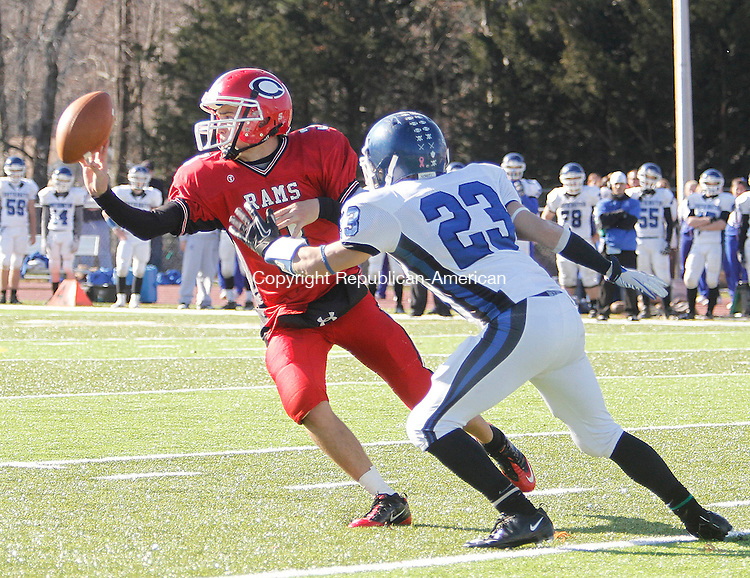 CHESHIRE,  CT.- 24 NOVEMBER 2011-112411JW02-  Cheshire # 3 Michael John Ecke mangaes to lateral the ball before being tackled by Southington #23Donald Rinaldi during the Thanksgiving Day game at Cheshire.<br /> Jonathan Wilcox Republican American