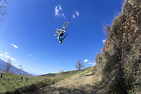 Gee Atherton  road gap backflip sequence..Near Bubion , Alpujarra region , Spain ,  March 2007..pic copyright Steve Behr / stockfile
