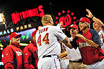 28 September 2010: Washington Nationals' first baseman Adam Dunn is congratulated by coaches after hitting a walk-off solo home run in the bottom of the 9th inning against the Philadelphia Phillies at Nationals Park in Washington, DC. The Nationals defeated the Phillies 2-1 to even up their 3-game series one game apiece. Mandatory Credit: Ed Wolfstein Photo