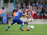 AFC Wimbledon's Dean Parrett tussles with Sheffield United's Mark Duffy during the League One match at the Kingsmeadow Stadium, London. Picture date: September 10th, 2016. Pic David Klein/Sportimage