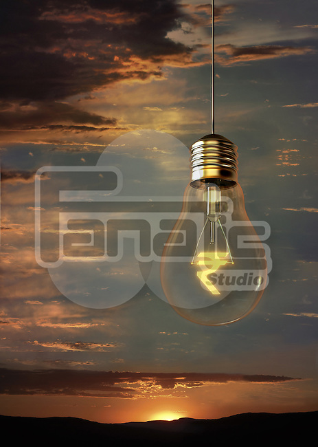 Illustrative image of rupee symbol in light bulb against cloudy sky