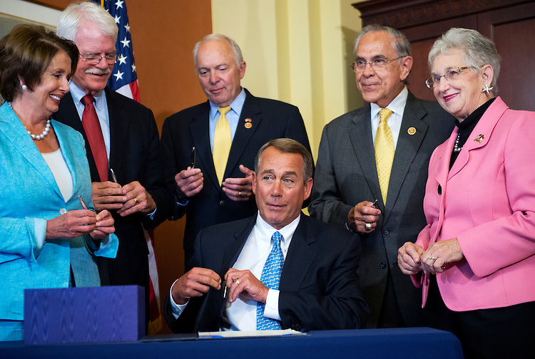 UNITED STATES - JULY 11: From left, House Minority Leader Nancy Pelosi, D-Calif., Reps. George Miller, D-Calif., John Kline, R-Minn., Speaker John Boehner, R-Ohio, Reps. Ruben Hinojosa, D-Texas, and Virginia Foxx, R-N.C., conduct a bill signing ceremony for the Workforce Innovation and Opportunity Act, in the Capitol, July 11, 2014. The bipartisan legislation is intended to improve job training programs to help those who are out of work, re-enter the job market. (Photo By Tom Williams/CQ Roll Call)
