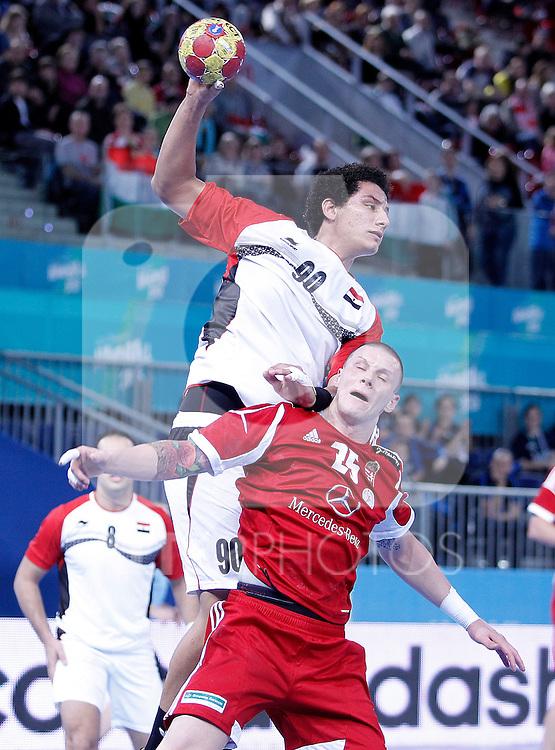 Hungary's Szabolcs Zubai (d) and Egypt's Ali Zein during 23rd Men's Handball World Championship preliminary round match.January 12 ,2013. (ALTERPHOTOS/Acero)