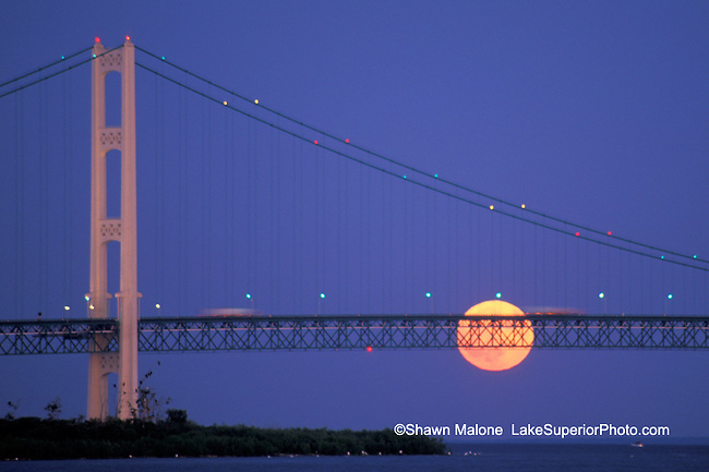 Mackinac bridge splitting full moon