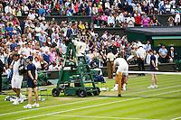 London, England, 01 July, 2016, Tennis, Wimbledon, Juan Martin Del Potro (ARG) defeates Stanislas Wawrinka (SUI) (L)<br /> Photo: Henk Koster/tennisimages.com