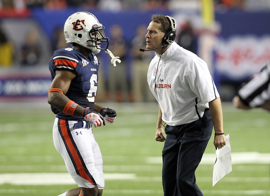 ATLANTA, GA - DECEMBER 31: Head coach Gene Chizik of the Auburn Tigers gives an ear full to Jonathon Mincy #6 of the Auburn Tigers  during the 2011 Chick Fil-A Bowl at the Georgia Dome on December 31, 2011 in Atlanta, Georgia. Auburn defeated Virginia 43-24. (Photo by Andrew Shurtleff/Getty Images) *** Local Caption *** Gene Chizik;Jonathon Mincy