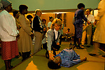 Woman helping George Canty, faith healer performing acts of healing at Kensington Temple at Pentecostal church in the Notting Hill area of London 1990s.