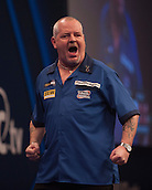 01.01.2014.  London, England.  William Hill PDC World Darts Championship.  Quarter Final Round.  Robert Thornton (9) [SCO] celebrates a finish during his game with Michael van Gerwen (1) [NED]