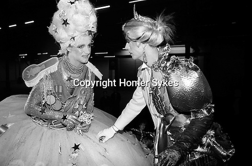 Andrew Logan, artist and organiser of The Alternative Miss World beauty pageant / competition.  Seen here with one of the contestants. (left)  Olympia West London 1981.<br />