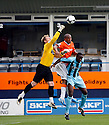 Simon Brown of Cambridge United punches clear under pressure from Taiwo Atieno of Luton during the Blue Square Bet Premier match between Luton Town and Cambridge United at Kenilworth Road, Luton  on 11th September 2010.© Kevin Coleman 2010